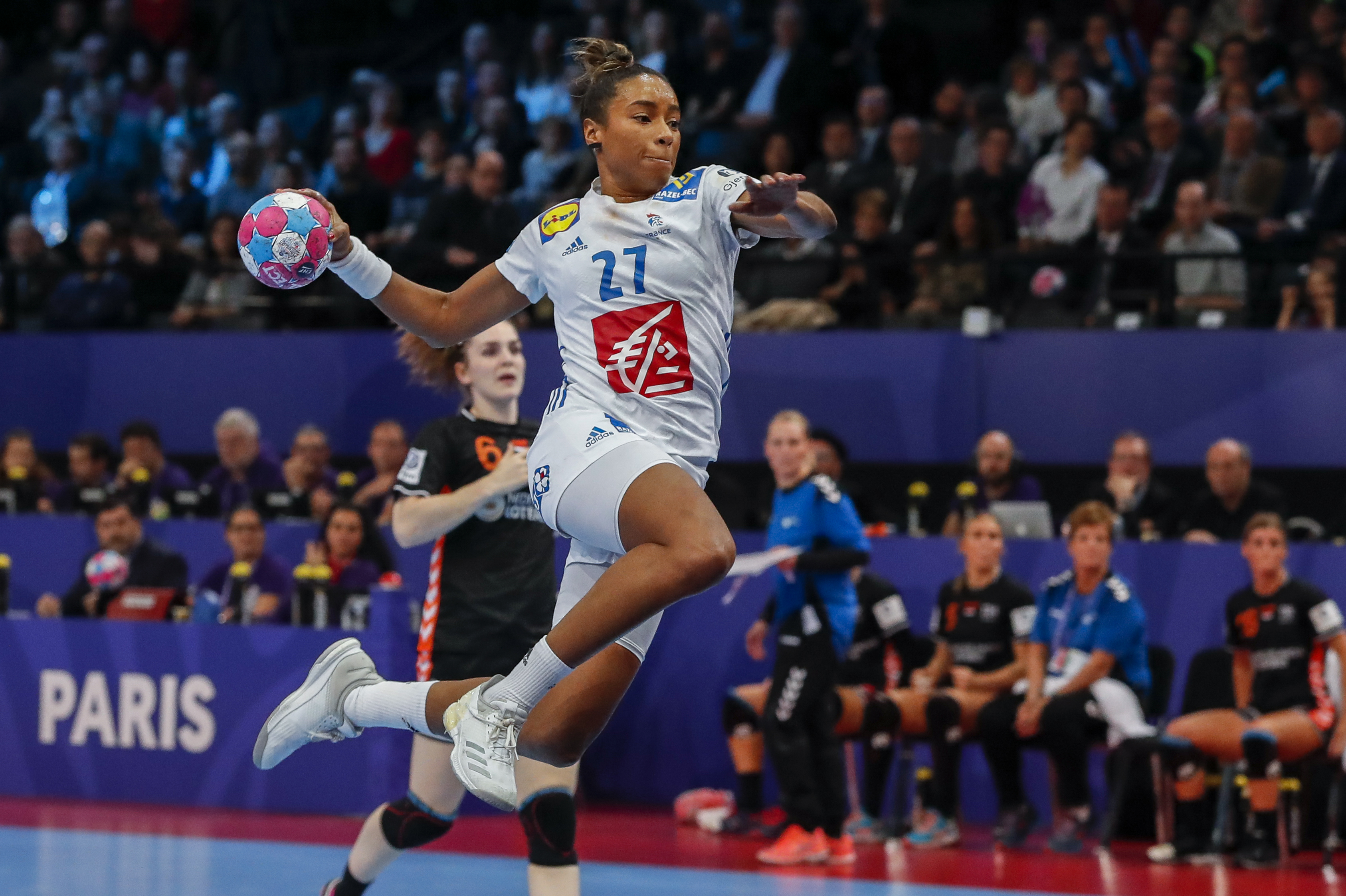 PARIS, FRANCE - DECEMBER 14: Estelle Nze Minko #27 of France is shooting the ball during the EHF Euro semi-final match between Netherlands and France at AccorHotels Arena on December 14, 2018 in Paris, France. (Photo by Catherine Steenkeste/Getty Images)